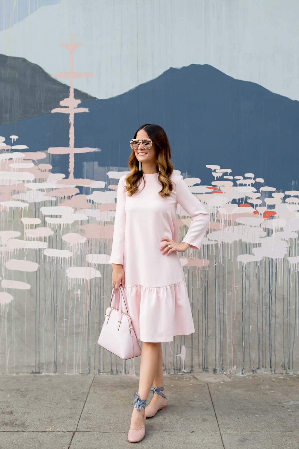 Jennifer Lake Style Charade in a pink Edit Easy Dress from Shopbop, Steve Madden Meow tie up flats, a pink Kate Spade Maise bag at Los Angeles Kim West mural street art