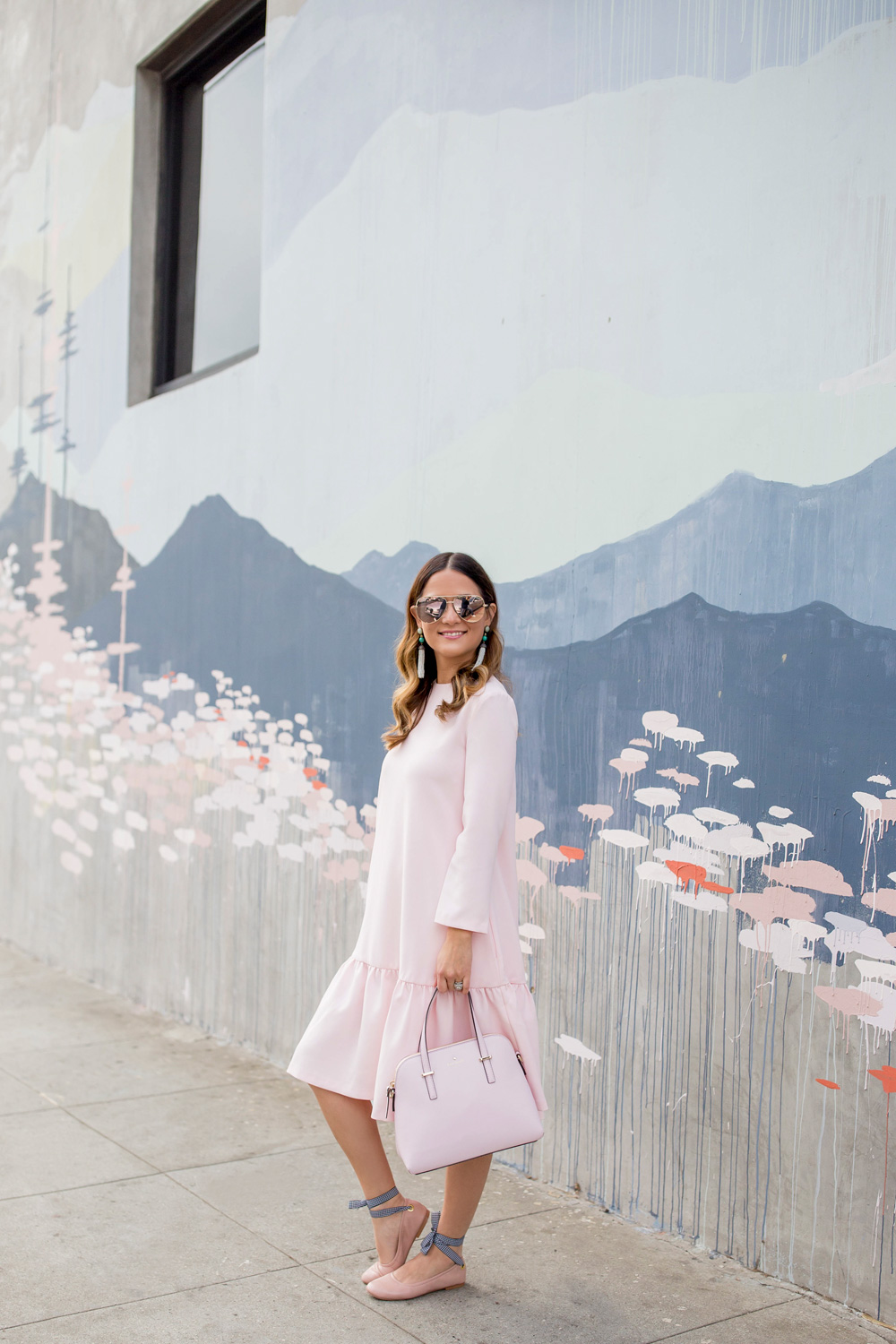 Jennifer Lake Style Charade in a pink Edit Easy Dress from Shopbop, Steve Madden Meow tie up flats, and a pink Kate Spade bag at a Los Angeles Kim West mural street art