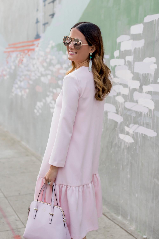 Jennifer Lake Style Charade in a pink Edit Easy Dress from Shopbop, Quay Australia High Key Sunglasses, BaubleBar tassel rarrings at Los Angeles Kim West mural street art