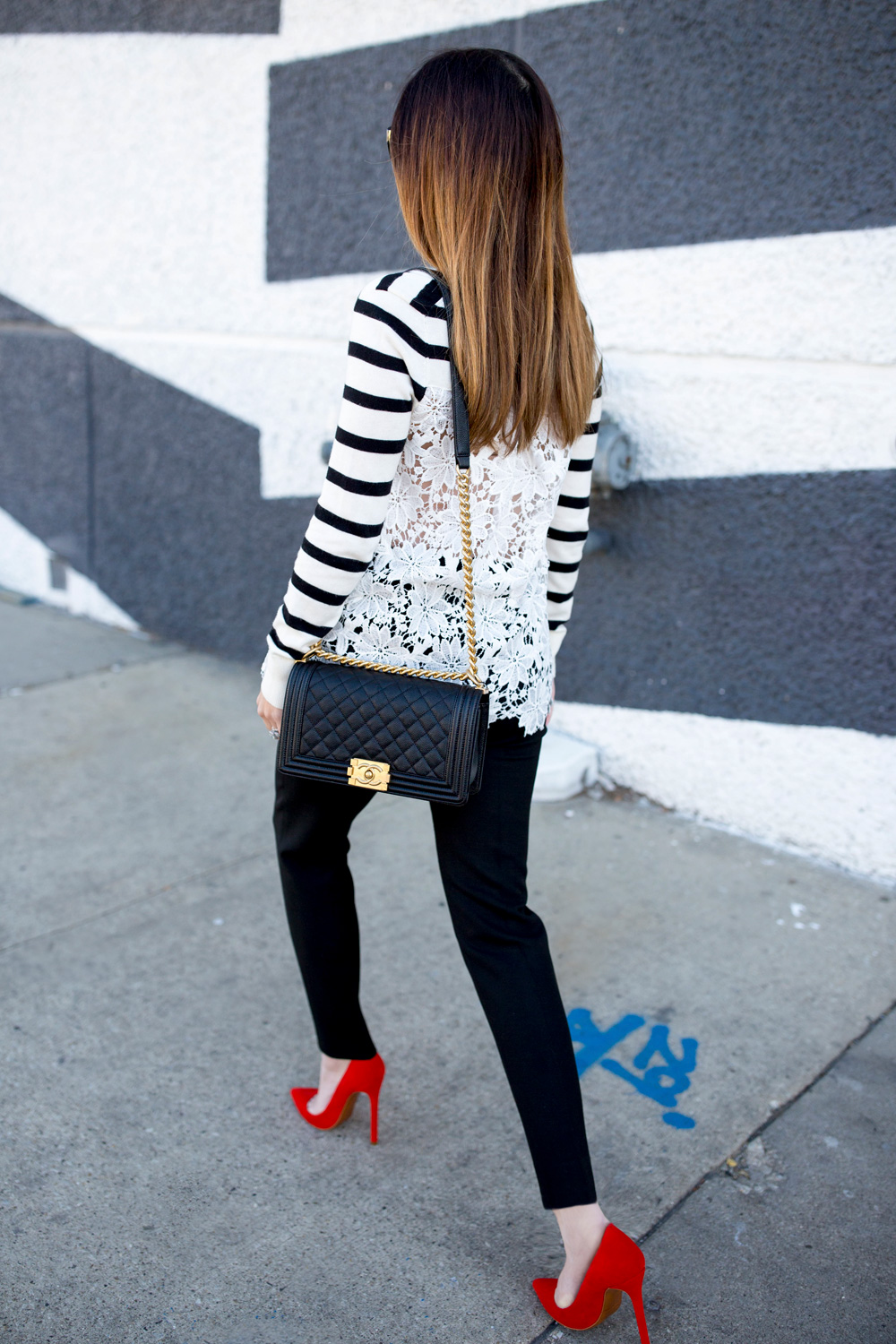 Jennifer Lake Style Charade in a black and white stripe sweater with lace detail, a black and gold Chanel Boy Bag and red pumps in Chicago