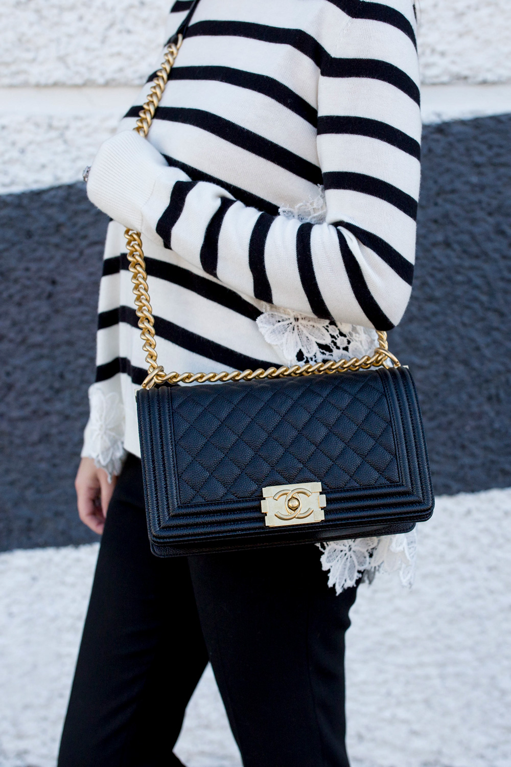 Jennifer Lake Style Charade in a black and white stripe sweater with lace detail, a Chanel Boy Bag in Chicago