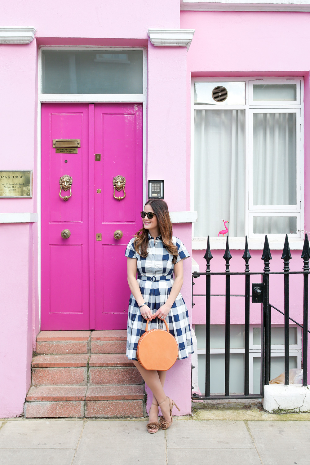 Jennifer Lake Style Charade in an Eliza J gingham dress and Mansur Gavriel circle bag at a pink home in Notting Hill London