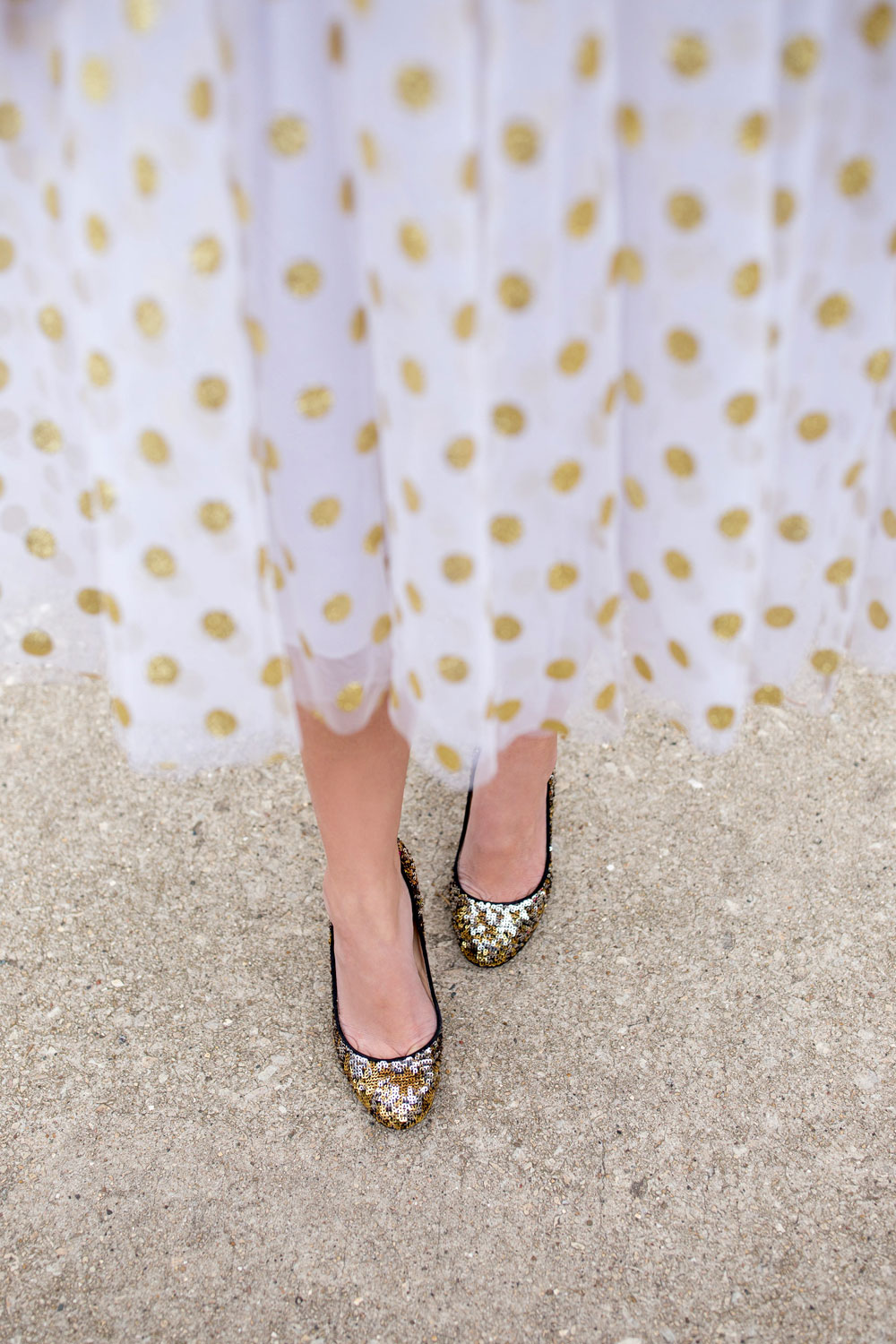 Jennifer Lake Style Charade in a T and J Designs gold glitter polka dot midi skirt and J Crew sequin pumps