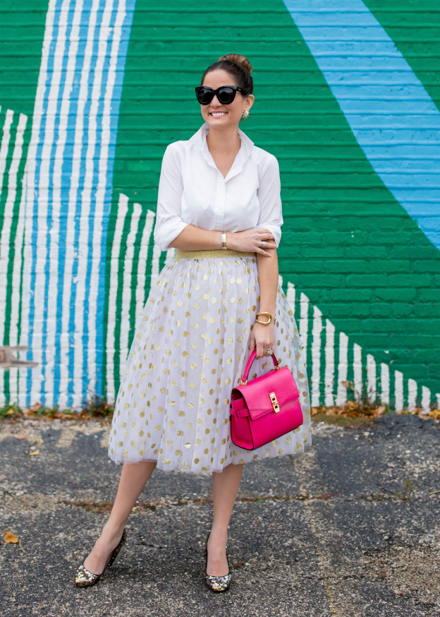 Jennifer Lake Style Charade in a T and J Designs gold glitter polka dot midi skirt, Henri Bendel Uptown Satchel and J Crew sequin pumps at a colorful Chicago mural