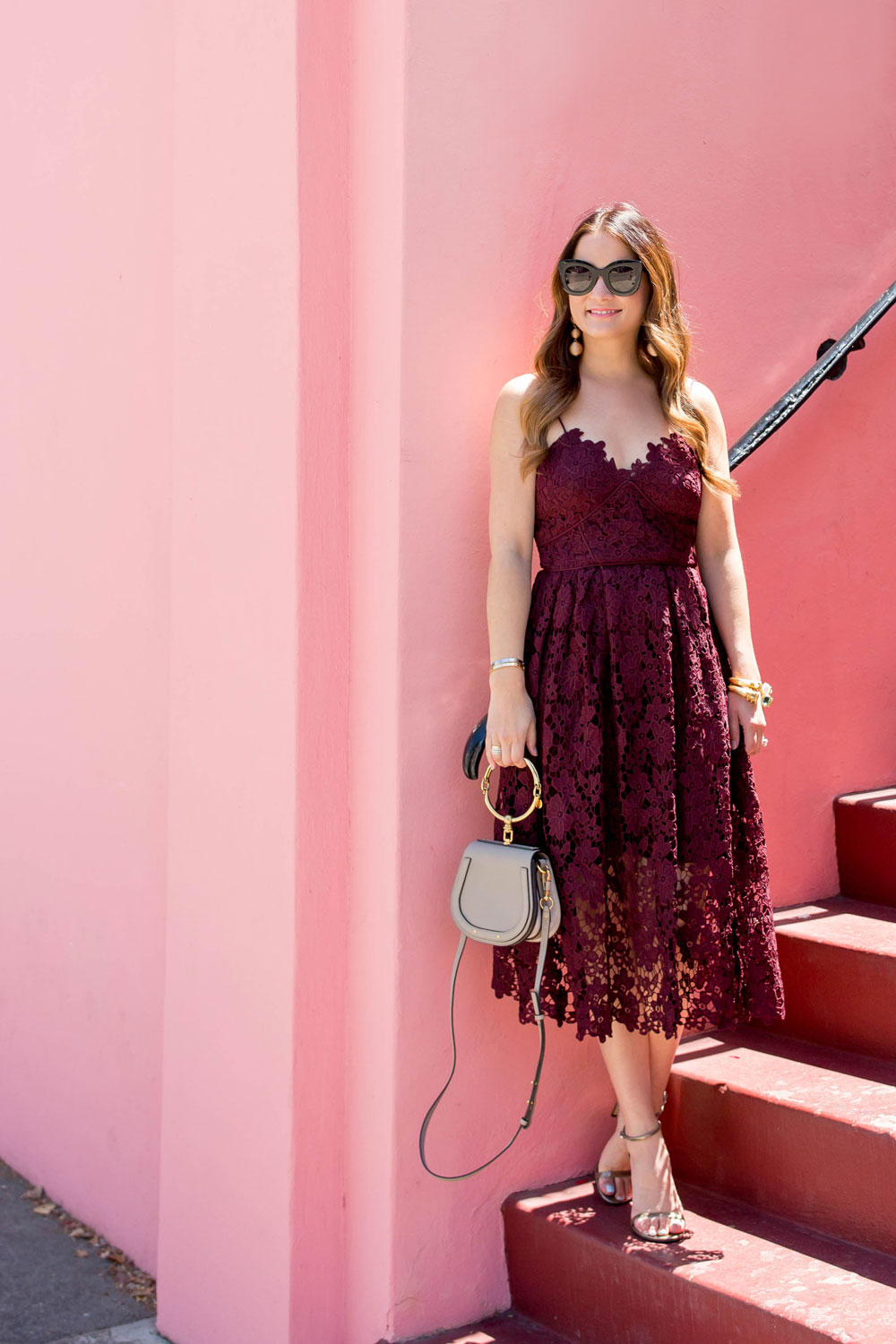 Burgundy Lace Midi Dress At A Pink Wall In San Francisco