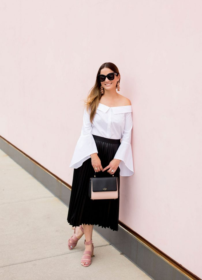 Black Faux Leather Pleated Skirt at a Chicago Pink Wall