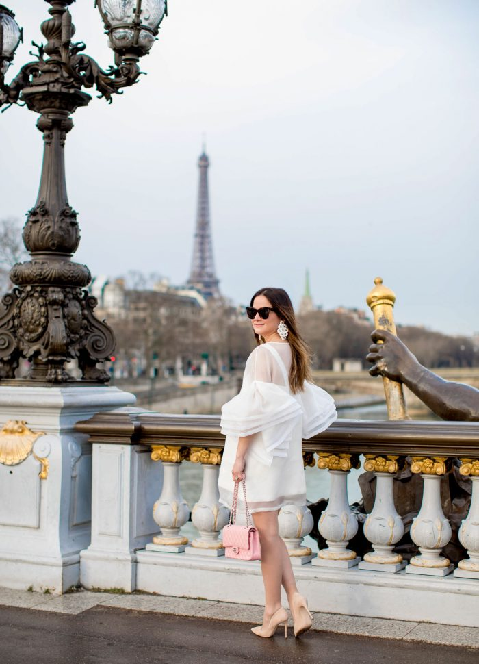 Leal Daccarett White Dress at Pont Alexandre Bridge in Paris